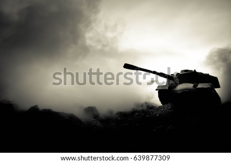 War Concept. Military silhouettes fighting scene on war fog sky background, World War Soldiers Silhouettes Below Cloudy Skyline At night. Attack scene. Armored vehicles. Tanks battle. Decoration #639877309