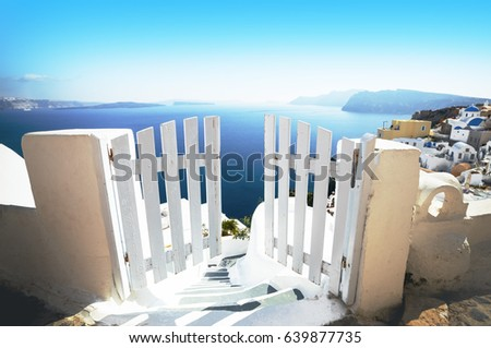 Open door in summer, vacation background. Oia village, Santorini, Greece, Europe location, famous and popular summer resort. White and blue color gamut photo, traditional Greek colors. #639877735