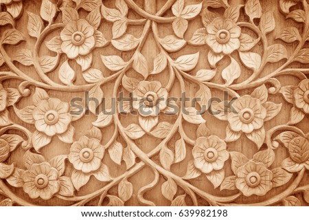 Pattern of flower carved on wood background #639982198