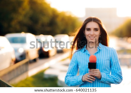 Female News Reporter on Field in Traffic - Woman journalist on the job as a live correspondent   #640021135