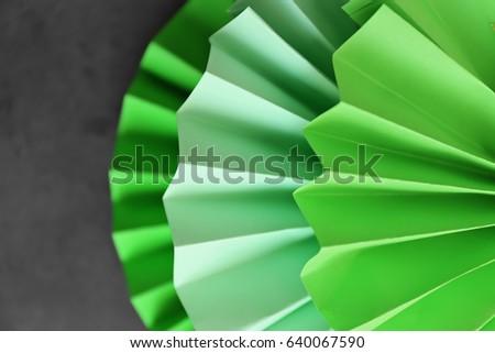 Beautiful green paper decoration on dark background, closeup #640067590