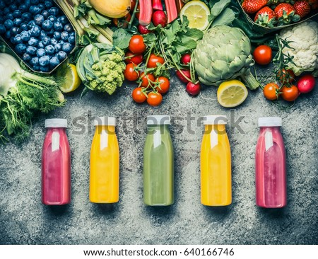 Variety  of colorful Smoothies or juices bottles beverages drinks with various fresh ingredients: fruits ,berries  and vegetables on gray concrete background , top view.  Healthy Food concept #640166746