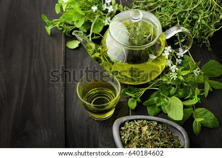 healthy green tea cup with tea leaves  Royalty-Free Stock Photo #640184602