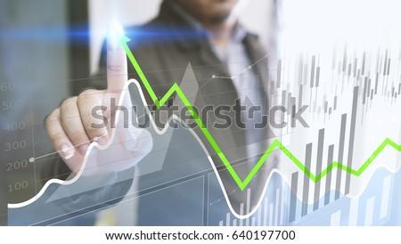 Businessman analysis finance diagram. Business graph background. financial graph                                #640197700