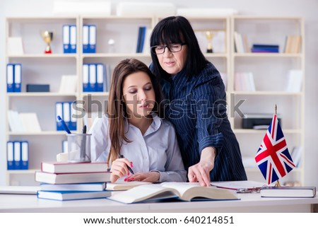 Young foreign student during english language lesson Royalty-Free Stock Photo #640214851