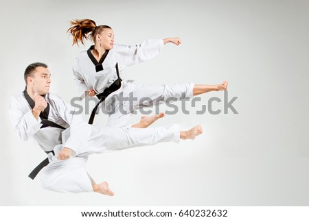 The karate girl and man with black belts #640232632