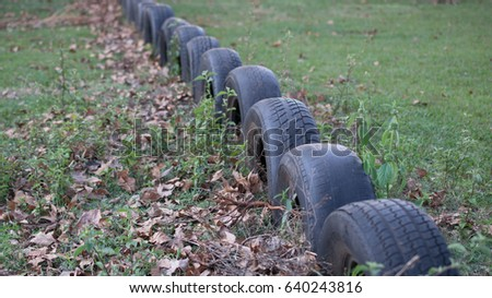 Recycled car tires used as a boundary marker #640243816