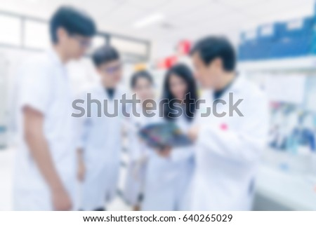 blurred background Laboratory and scientist working at chemistry laboratory, science concept. #640265029