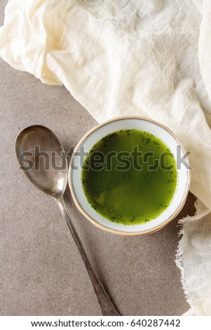 Green Italian soup made from cabbage kale in a white plate. Dark background #640287442