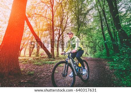 MTB Cyclist in the forest sunlight, woods sunshine, recreation, sports, nature #640317631