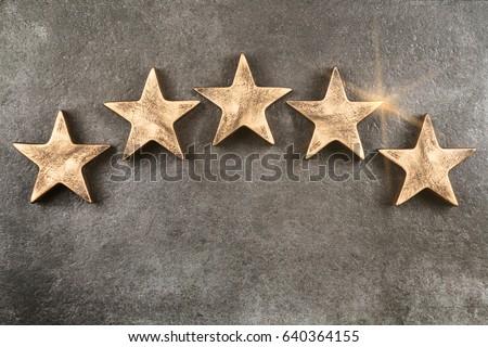 Five stars on dark background Royalty-Free Stock Photo #640364155