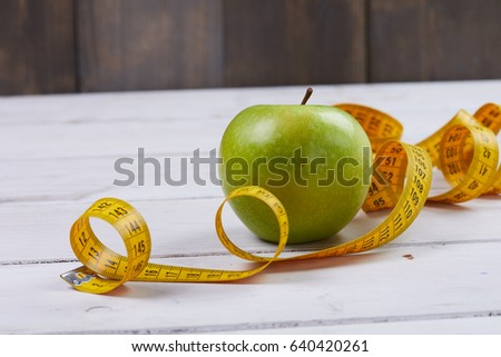 apple with measuring tape #640420261