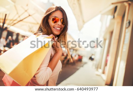Woman in shopping. Happy woman with shopping bags enjoying in shopping. Consumerism, shopping, lifestyle concept Royalty-Free Stock Photo #640493977