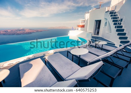Bright morning view of Santorini island. Picturesque spring scene of the famous Greek resort Fira, Greece, Europe. Traveling concept background. #640575253