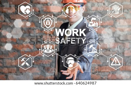 Work Safety Concept - regulations and standard in industry, business. First secure rules. Health protection, personal security people on job. Man in helmet offers work safety icon on virtual screen. Royalty-Free Stock Photo #640624987