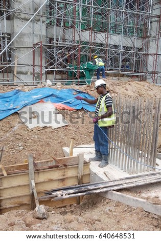 JOHOR, MALAYSIA -MARCH 29, 2016: Construction workers spraying the anti termite chemical treatment to the soil at the construction site.  #640648531