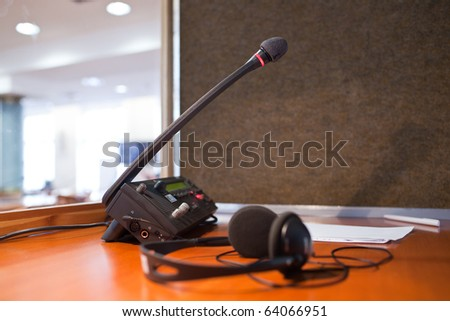 interpreting - Microphone and switchboard in an simultaneous interpreter booth (shallow DOF) Royalty-Free Stock Photo #64066951