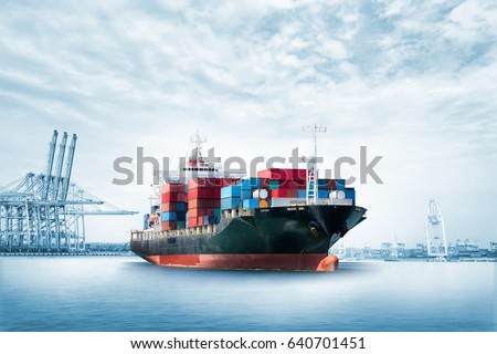 Logistics import export background of Container Cargo ship in seaport on blue sky, Freight Transportation Royalty-Free Stock Photo #640701451