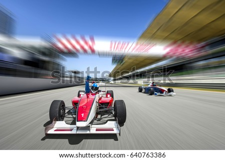 driver celebrate victory pass the finishing point and Race car racing on a track with motion blur. Royalty-Free Stock Photo #640763386