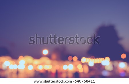 vintage tone blur image of night festival on street with bokeh for background usage . #640768411