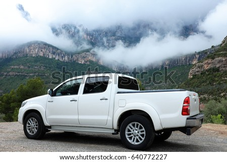 Montserrat, Spain - April 26: Photo a white pick up car with mountains in the background near a monastery in the region of Catalonia on April 26, 2017 in Montserrat, Spain. #640772227