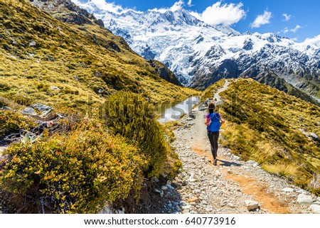New zealand hiking girl hiker on Mt Cook Sealy Tarns trail in the southern alps, south island. Travel adventure lifestyle tourist woman walking alone on Mueller Hut route in the mountains. #640773916