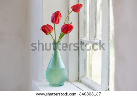 red tulips in vase on white background #640808167