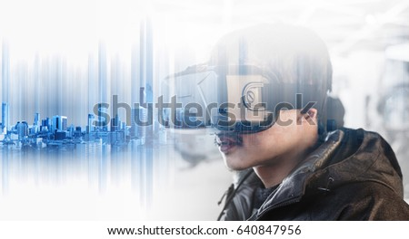 Businessman wearing virtual reality googles, with double exposure modern buildings technology #640847956