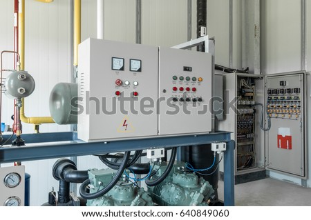 room with control box and distribution. panel switchgear for compressor control Royalty-Free Stock Photo #640849060