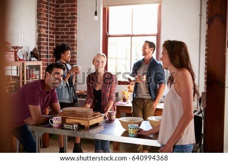 Five friends laughing over coffee in kitchen, close up #640994368