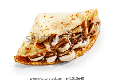 Banana pancake crepes with chocolate sauce and chopped nuts for a tasty dessert folded over a white background for a menu or advertising Royalty-Free Stock Photo #641013640