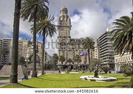 centrally located salvo palace (palacio salvo) seen from plaza independencia (independence square) surrounded with palms and lawns. montevideo, uruguay #641082616