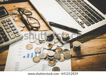 Personal financial planning concept. Businessman workplace with papers for financial planning. Business people discussing the charts and graphs showing the results of successful financial planning. #641252839