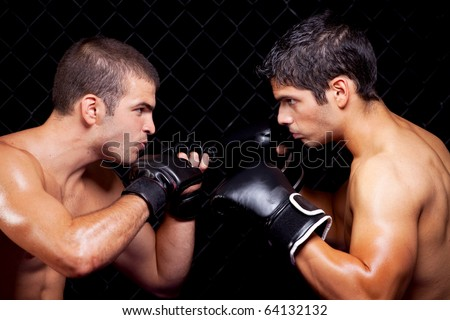 Mixed martial artists before a fight Royalty-Free Stock Photo #64132132