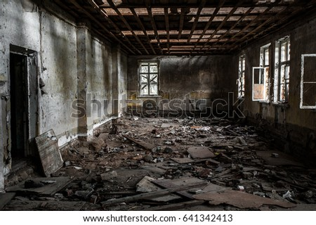 An old abandoned building. Terrible room. Ruins. Broken Windows.Windows filled with boards. #641342413