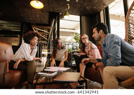 Group of creative people having a meeting in a modern office. Business people having conversation over new project. #641342941