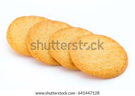 Stacked short pastry cookies isolated on white background. #641447128