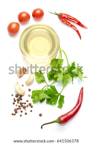 Spicy mediterranean cuisine & healthy diet: Fresh Italian herbs vegetables spices.  Closeup Isolated on white. Top view.  Italian herb olive oil chili pepper and cherry tomatoes #641506378
