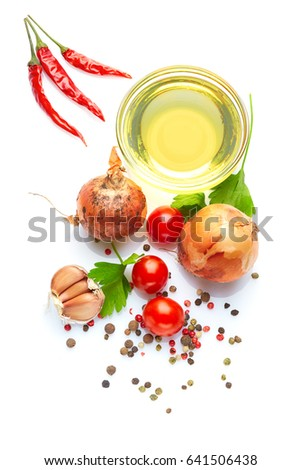 Spicy mediterranean cuisine & healthy diet: Fresh Italian herbs vegetables spices.  Closeup Isolated on white. Top view. Italian herb olive oil chili pepper and cherry tomatoes  #641506438