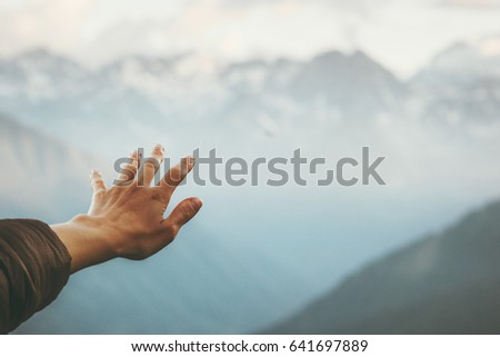 Hand touching Mountains landscape emotional Travel Lifestyle wanderlust concept adventure summer vacations outdoor calm harmony with nature #641697889