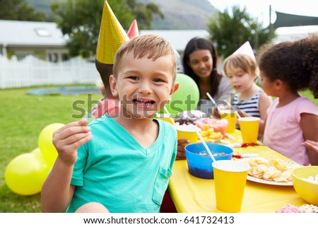 Mother With Children Enjoying Outdoor Birthday Party Together #641732413