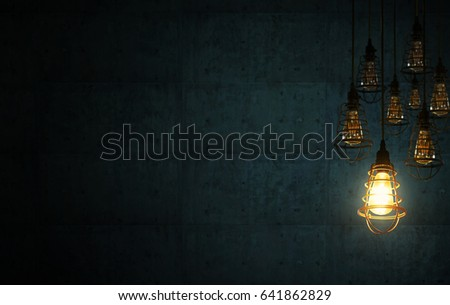 Idea concept with retro light bulbs on the dark blue cement interior background . #641862829