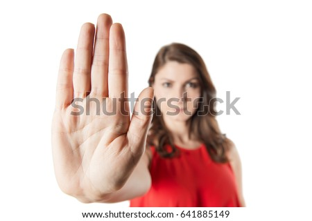 A woman making stop gesture with her hand Royalty-Free Stock Photo #641885149