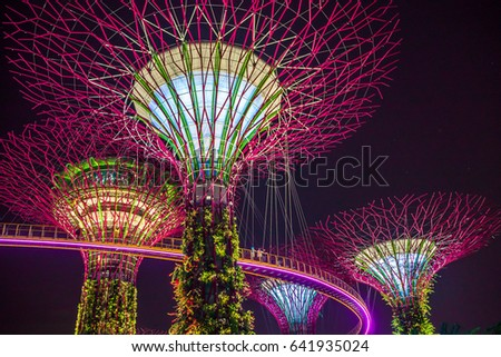 Supertree in Singapore in night time. Supertree is famous spot for traveler in Singapore city. It's weird building covered by plant. Supertree will be most beautiful in night time. When the light on. #641935024
