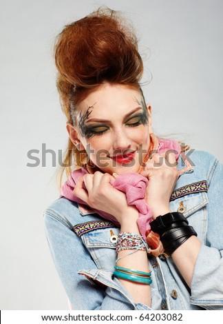 portrait of glam punk redhead girl posing on gray #64203082