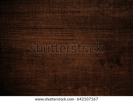 Brown dark scratched wooden cutting, chopping board. Wood texture. #642107167