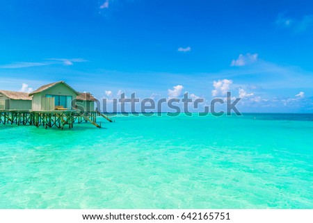Beautiful water villas in tropical Maldives island #642165751