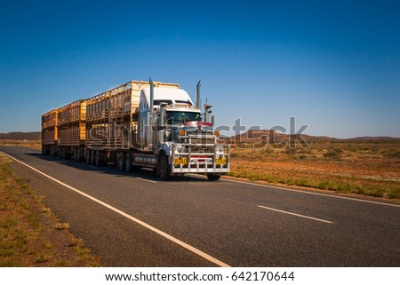 ALICE SPRINGS, AUSTRALIA - CIRCA AUGUST 2016: Road Train on the Stuart Highway, Northern Territory, Australia #642170644