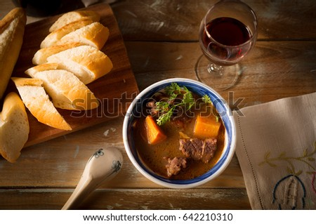 Vietnamese cuising beef stew with bread and red wine #642210310