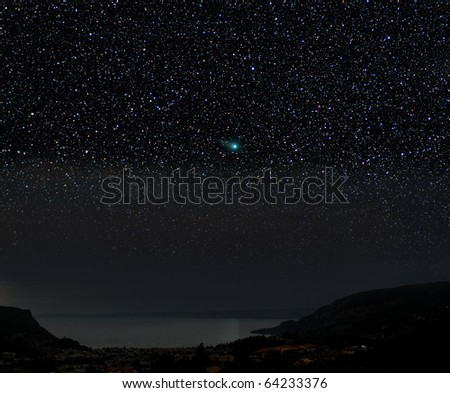 A comet in a night time scene. The Christmas star? #64233376